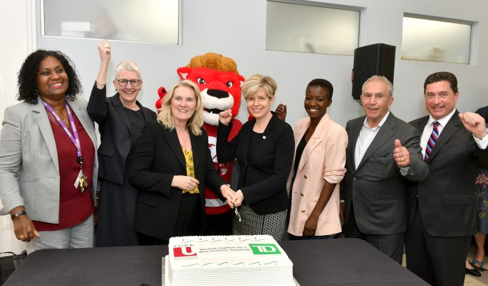 Celebrating a decade of impact in the Black Creek community. Above: From left, Cheryl Prescod, executive director, Black Creek Community Health Centre; Professor Alice Pitt, vice-provost academic; York University President and Vice-Chancellor Rhonda L. Lenton; Yeo, the York University mascot; TD Bank Group Head, Customer and Colleague Experience and York alumna Norie Campbell; Abena Offeh-Gyimah; York University Chancellor Greg Sorbara; and York Vice-President Advancement Jeff O'Hagan